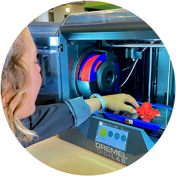 Staff interacting with 3D Printer